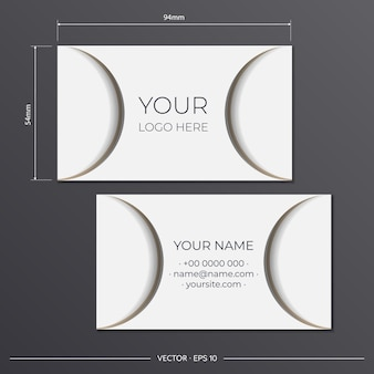Template for print design business cards of white color with beige patterns. preparing a business card with a place for your text and an abstract ornament.