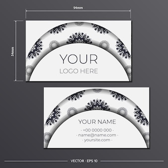Template for print design of business cards of white color with greek ornament. vector business card preparation with place for your text and luxurious patterns.