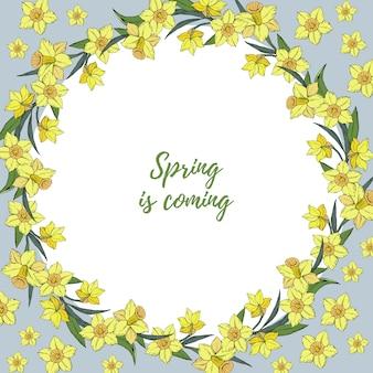 花の黄色い水仙の花輪を持つテンプレート