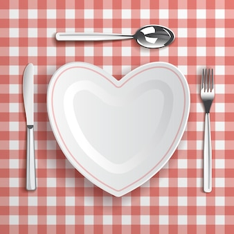 Template with table appointments and heart-shaped plate