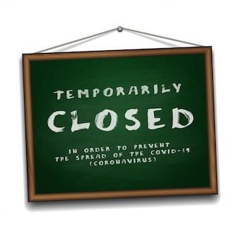 木製フレームの緑の黒板にコロナウイルスのニュースの一時的に閉じた看板。