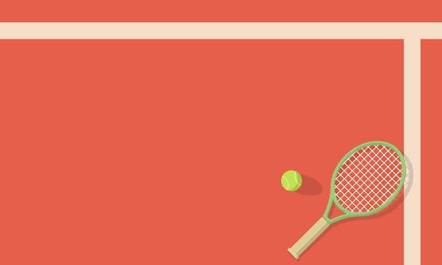 테니스 라켓과 공을 코트에 누워