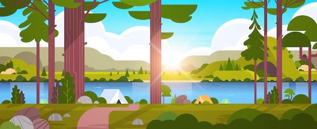 Tents camping area in forest summer camp concept sunny day sunrise landscape nature with water mountains and hills