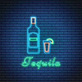 Tequila bottle and glass with lettering in neon style on brick background. cocktail bar symbol, logo, signboard.