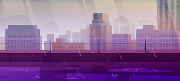 街の景色を望む雨の鈍い天気の屋上テラス