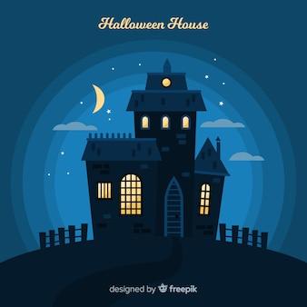 Потрясающий дом с привидениями на хэллоуин с плоским дизайном