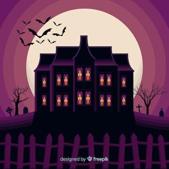 Terrific halloween haunted house with flat design