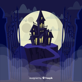 Terrific halloween haunted house with flat design