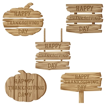 Testo happy thanksgiving day con una varietà di cartelli in legno