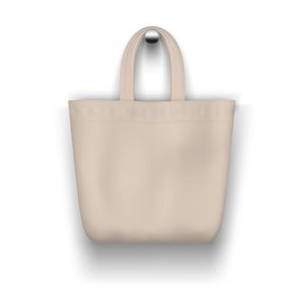 Текстильная бежевая большая сумка висит на стене реалистично для покупок.