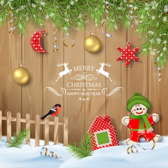 Textile toys and branches of fir tree with hanging decorations
