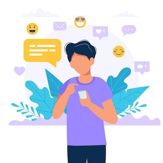 Человек texting с смартфон, иконки социальных медиа.