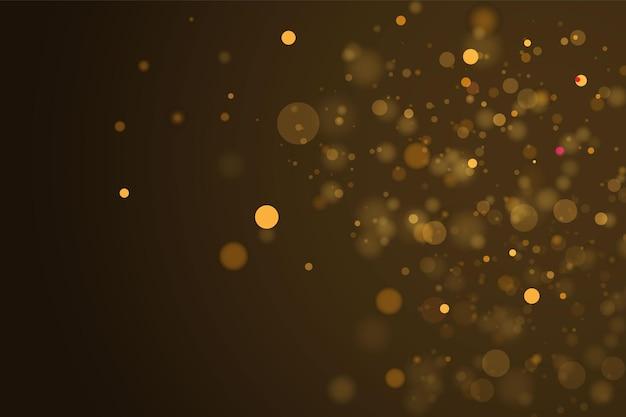 Текстура блестящая и элегантная на рождество. сверкающие волшебные золотисто-желтые частицы пыли. магическая концепция. абстрактный прозрачный фон с эффектом боке.