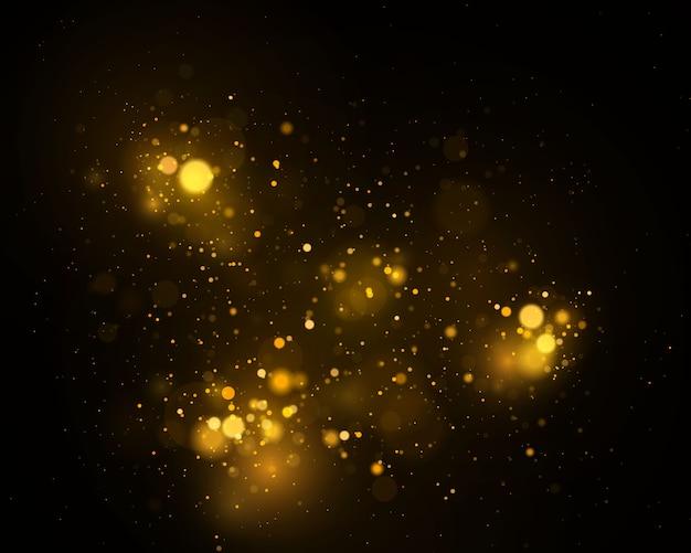 キラキラとエレガントな風合い。きらめく魔法の金黄色いダスト粒子。魔法のコンセプト。ボケ効果で抽象的な黒の背景。