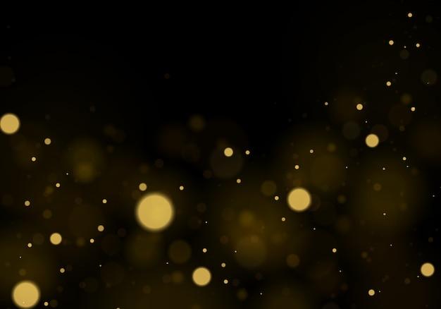 반짝이는 우아한 질감. 반짝이는 마법의 금색 먼지 입자. 마법의 황금 개념입니다. bokeh 효과와 추상 검정색 배경입니다.