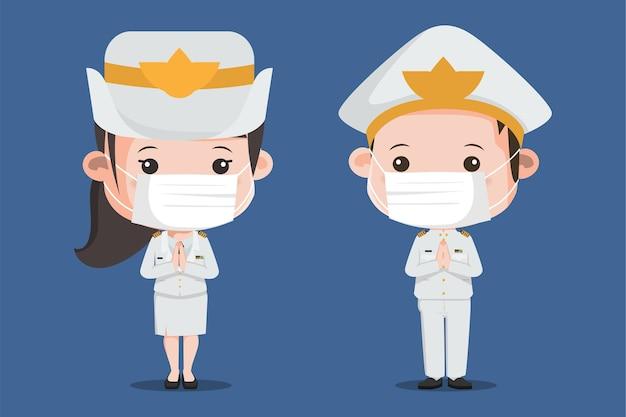 コロナウイルスから身を守るため、タイ政府が白い制服を着たフェイスマスクを着用