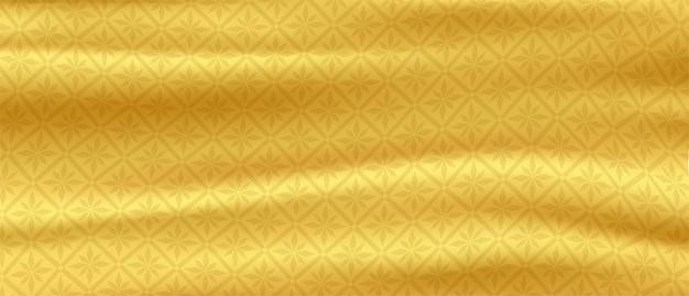 タイのパターン黄金のシルクの背景ゴールドのサテンの波ベクトル