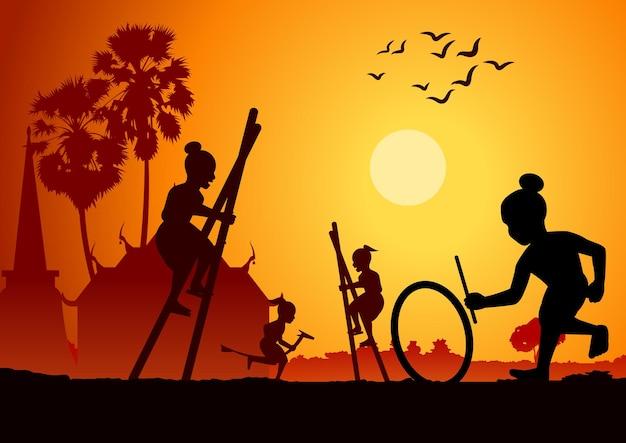 タイの遊び、バナナの馬に乗って、足をカテと打つ車輪