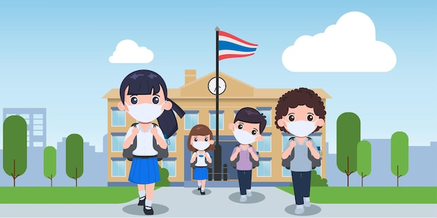 学校で医療用マスクを持っているタイの学生