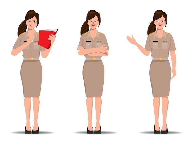 균일 한 서있는 포즈를 입고 태국 방콕에서 태국 교사. 새로운 정상적인 라이프 스타일 정부 캐릭터.