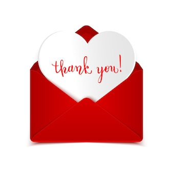 Thank you handwritten calligraphic text message in open red envelope with paper heart on white