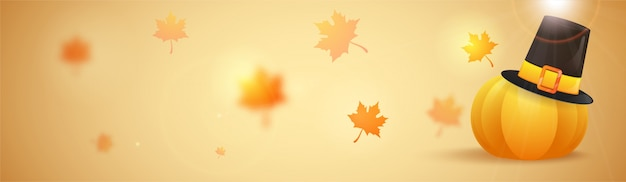 Thanksgiving day concept with pumpkin and pilgrim hat on autumn leaves decorated background.