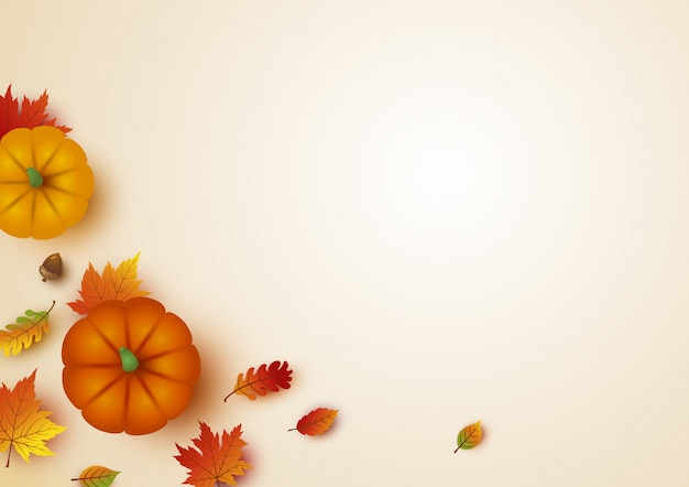 Thanksgiving design of pumpkin and maple leaves with copy space