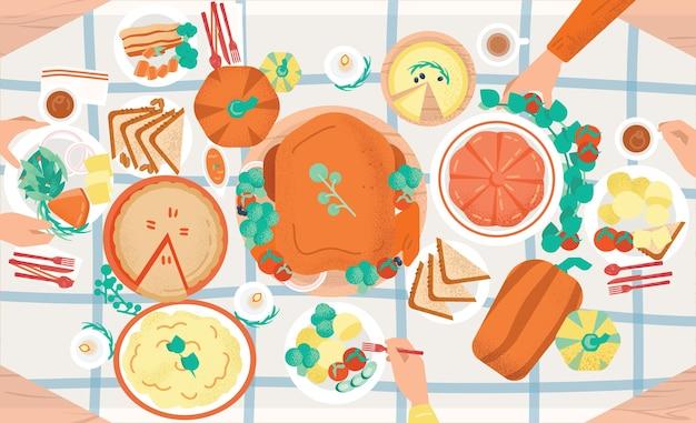 感謝祭のお祝いディナー。プレートとそれらを食べる人々の手の上に横たわるおいしい伝統的な休日の食事
