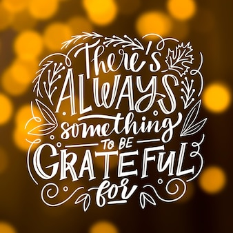 Thanksgiving lettering on blurred background