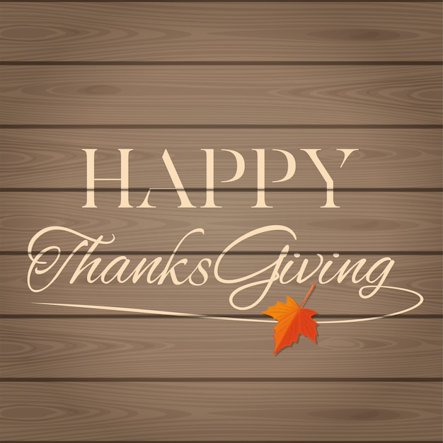 Thanksgiving lettering on a wooden background. happy thanksgiving. lettering card for thanksgiving day.