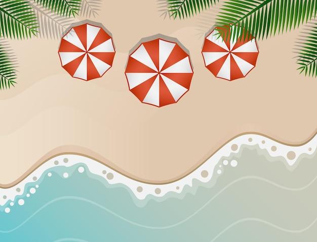 柔らかい砂と赤と白の傘のあるビーチの雰囲気
