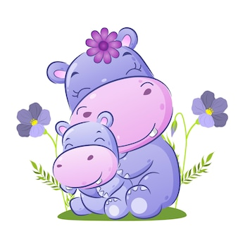 Большой бегемот сидит за своим ребенком в саду иллюстраций
