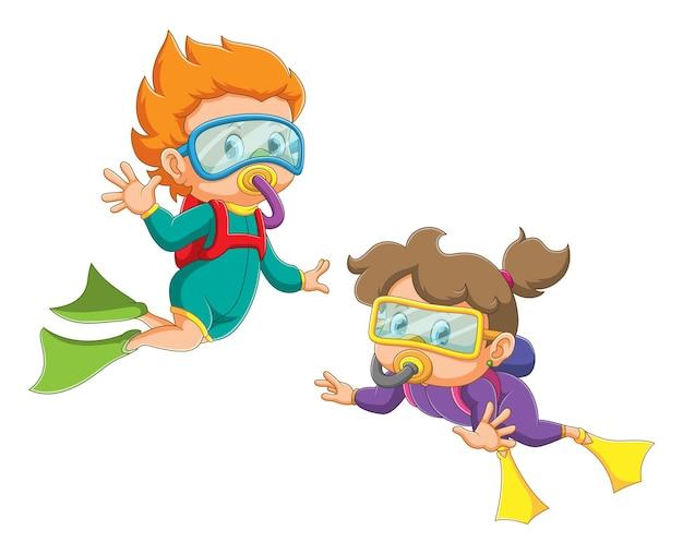 소년과 소녀는 다이빙 복과 오리발을 사용하고 있습니다.