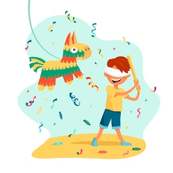 Мальчик поражает пиньяту в традиционных цветах