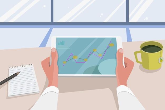 사무실의 사업가는 통계 그래프를 작동하고 분석합니다.