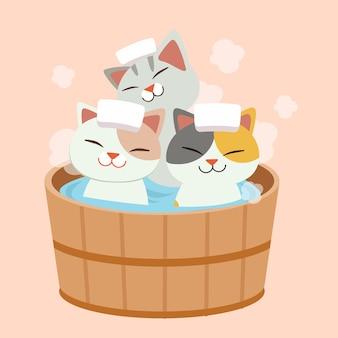 かわいい猫のキャラクターは日本の温泉風呂に入ります。猫は温泉を取っています。それは幸せでリラックスして見える