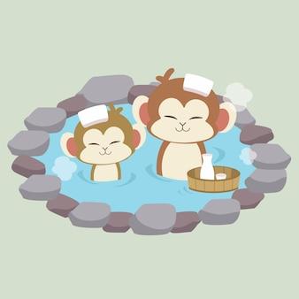 かわいい猿のキャラクターが日本の温泉風呂に入る