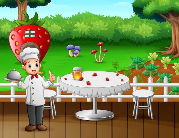 シェフがレストランのテーブルに食べ物を持ってきます