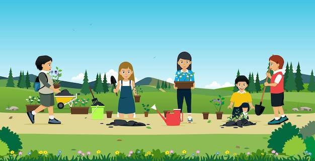 子供たちは花やアクセサリーで木を植えるのを手伝いました