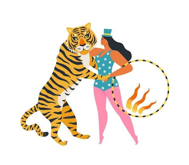 Цирковой тигр танцует с женщиной, держащей огненное кольцо