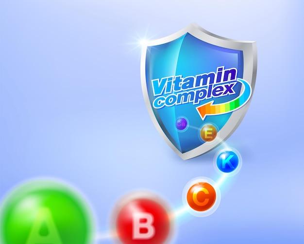비타민 복합체의 개념은 파란색 유리 방패를 향합니다.