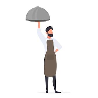 Повар держит металлическую посуду с крышкой. официант с пробелом.