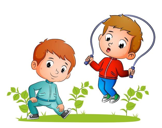 Пара мальчиков делает растяжку и прыгает в саду иллюстраций.