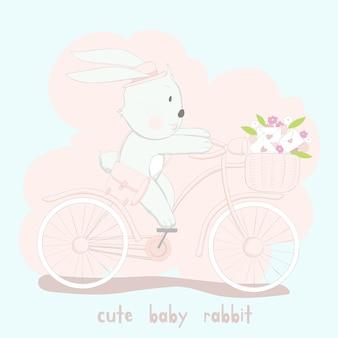 분홍색 자전거에 귀여운 아기 토끼