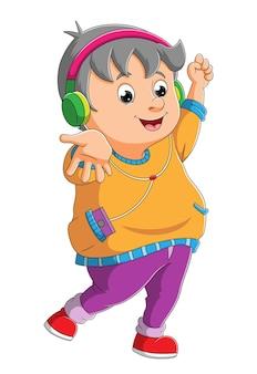 귀여운 소년이 춤을 추며 삽화의 음악을 듣습니다.
