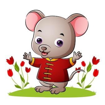 귀여운 중국 쥐가 삽화의 손을 흔들고 있다