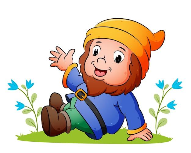 かわいい小人は草の上に座って、イラストの手を振っています
