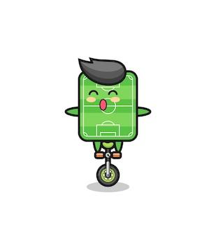 かわいいサッカー場のキャラクターはサーカスの自転車に乗っています、tシャツ、ステッカー、ロゴ要素のかわいいスタイルのデザイン