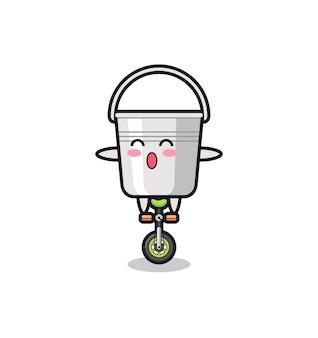 귀여운 금속 버킷 캐릭터가 서커스 자전거를 타고 있고, 티셔츠, 스티커, 로고 요소를 위한 귀여운 스타일 디자인