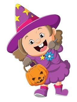 무서운 호박과 삽화의 마술 지팡이를 들고 있는 귀여운 마녀 소녀